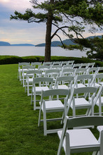 Empty White Chairs Ready For C...