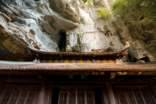Stunning Shot Of Beams Of Sunshine Hitting The Ancient Wooden Temple Roof At The Bich Dong Pagoda In Tam Coc, Vietnam, Asia