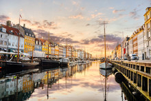 Nyhavn Canal With Boats And Colorful Buildings In The Sunrise Light