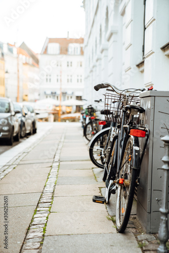Old bicycles parked in the streets of cycling capital Wallpaper Mural