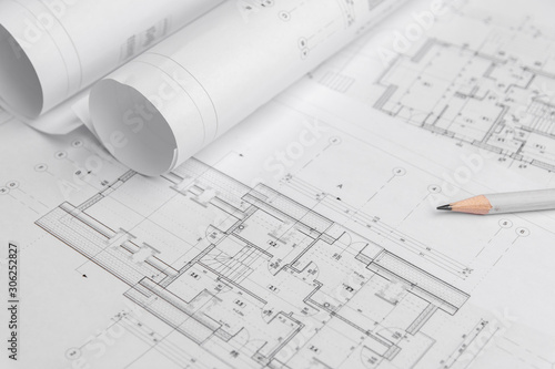Obraz Architect rolls and architectural plan,technical project drawing - fototapety do salonu