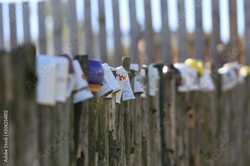 Photo Mugs on the wood fence