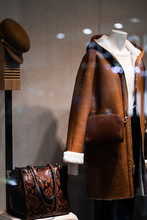 Female Mannequins Demonstrate Brown Coats In A Women's Store In Store Window Show Autumn Winter Collection . Standing Women Dummies Show Casual Style Collection Of Clothes. Black Friday. Vertical