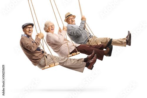 Happy senior people swinging on swings Wallpaper Mural