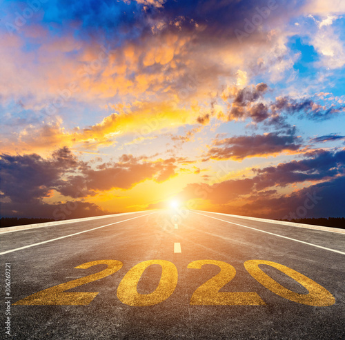 Empty asphalt roads and the New Year 2020 concept. The 2020 number on the straight highway. Wall mural