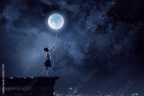Obraz Kid girl catching moon. Mixed media - fototapety do salonu