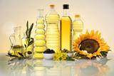 Fototapeta Zwierzęta - Healthy oil from sunflower, olive, rapeseed oil. Cooking oils in bottle