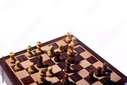Top angle shot of chess pieces on chessboard against white background Canvas Print