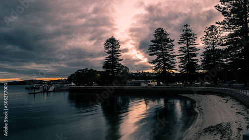 Moody sunrise clouds and bay