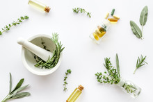 Medicine Made From Wildflowers And Herbs With Essential Oils -pattern With Mortar And Pestle On White Background Top View