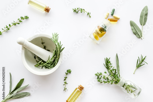 Photo Medicine made from wildflowers and herbs with essential oils -pattern with morta
