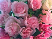 Top View With Bouquet Of Pink Roses On The Table