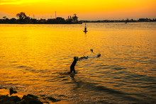 The Fisherman Cast A Net The Sea In The Morning, At Sunrise, Songkhla Thailand