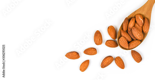 Almonds nuts on wooden spoon / Close up almond isolated on white background Canvas Print
