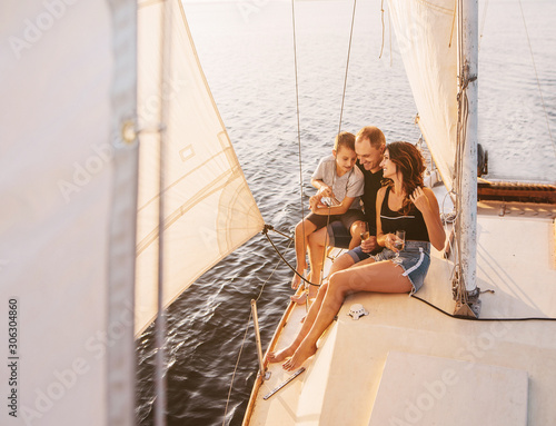 Fotografiet Happy family sailing on a luxury yacht or catamaran boat
