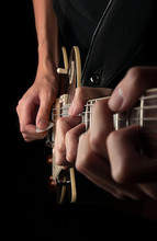 Three Hands Playing Guitar