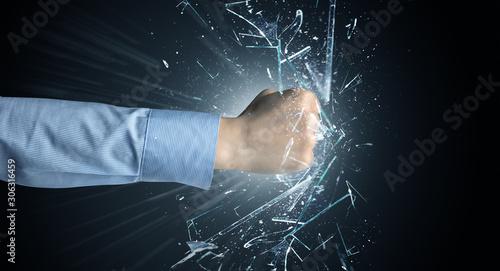 Obraz na plátně  Big hand hits intense and breaks glasses
