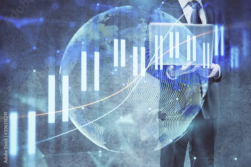 Forex graph with businessman working on laptop on background. Concept of hardworking. Multi exposure.