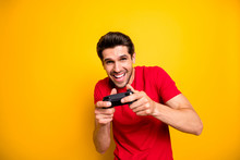 Portrait Of Cheerful Guy Play Video Games Use Joy Stick Want Win Winner In Speed Race Wear Stylish Clothing Isolated Over Yellow Color Background