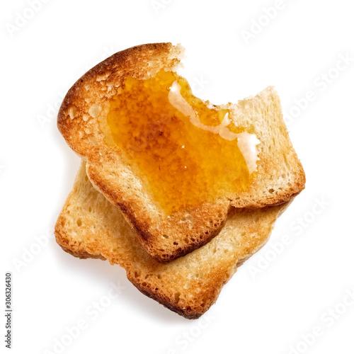 Obraz na płótnie Two slices toasted bread covered with honey