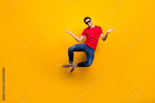 Full length photo of cheerful candid guy enjoy luxury resort spring time recreation jump wear casual style outfit isolated over vibrant color background