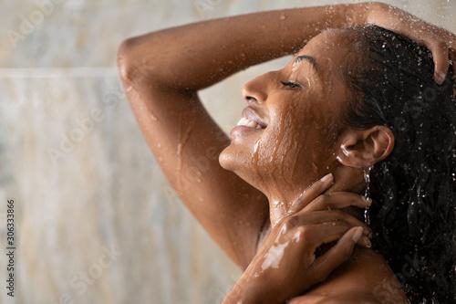 Tela Black beautiful girl relaxing in the shower