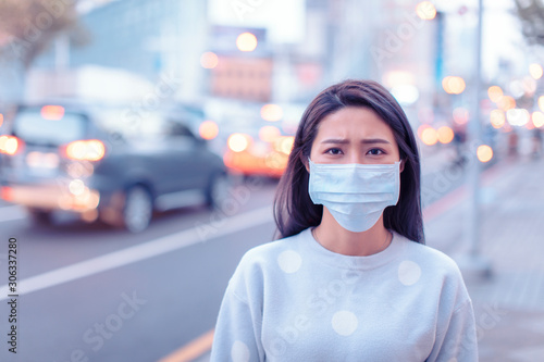 fototapeta na lodówkę young woman wear mask in the city during Smog day