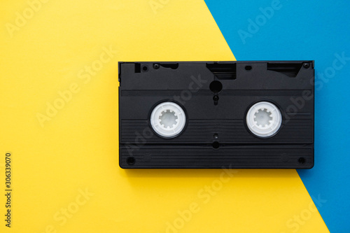 Video cassette on yellow and blue background Canvas-taulu