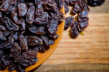 Dried Healthy Grapes Photographed On A Wooden Surface Close-up.