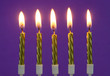 canvas print picture - Golden birthday candles on purple background