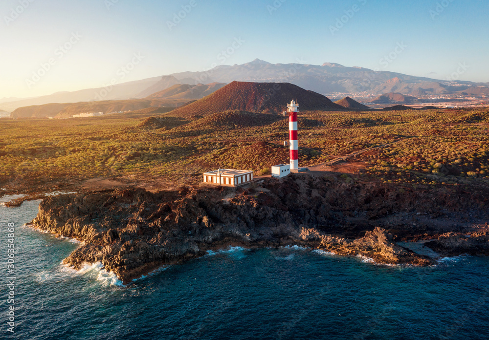 Fototapety, obrazy: View from the height of the lighthouse Faro de Rasca at sunset on Tenerife, Canary Islands, Spain. Wild Coast of the Atlantic Ocean