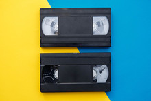 Two Video Tapes On Yellow And ...