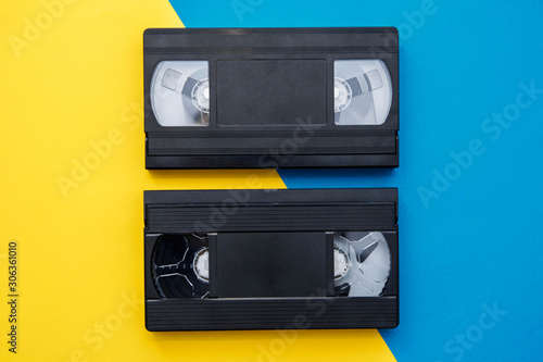 Two video tapes on yellow and blue background Fototapet