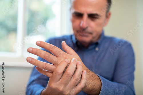 Mature Man Suffering With Repetitive Strain Injury Wallpaper Mural