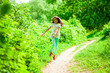 canvas print picture - Beautiful young little girl running summer park