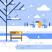 Winter Park Scene, Small Bench At River Bank, Snowing Weather, Beautiful View, Group Of Residential Houses In Background