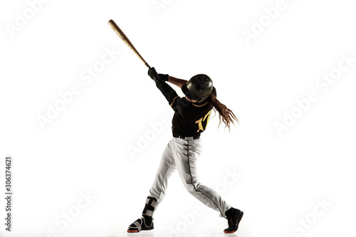 Fototapeta Baseball player, pitcher in a black uniform practicing and training isolated on a white background. Young professional sportsman in action and motion. Healthy lifestyle, sport, movement concept. obraz