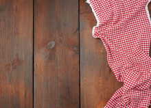 White Red Checkered Kitchen Towel On A Brown Wooden Background