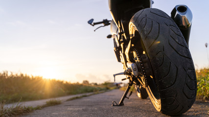 motorcycle in a sunny motorbike on the road riding.with sunset light. copyspace for your individual text. Lower corner