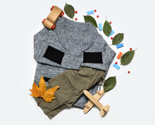 Stylish Autumn Kid Clothes With Leaves And Toys On White Background