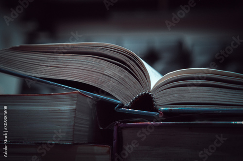 Stack of book for education learning in textbook literature at academic on reading desk in library school study classroom Canvas Print