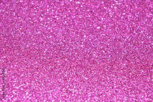 Beautiful Abstract Sparkle Glitter Lights Background. Bright Pink Fuchsia. Shine Bokeh Effect. For party, holidays, celebration. - 306391269
