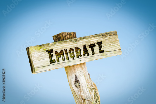 Street Sign to Emigrate Wallpaper Mural