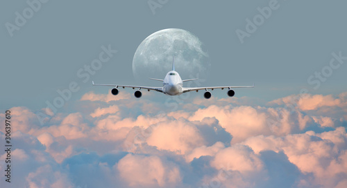 Photo White passenger airplane in the clouds with full moon - Travel by air transport