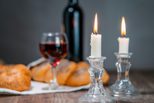 Shabbat Shalom. Challah Bread, Shabbat Wine And Candles On Wooden Table.