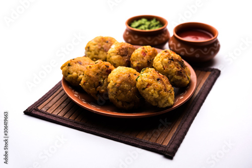 Photo Veg Poha Cutlet or flattened Rice Patties served with tomato ketchup and green c