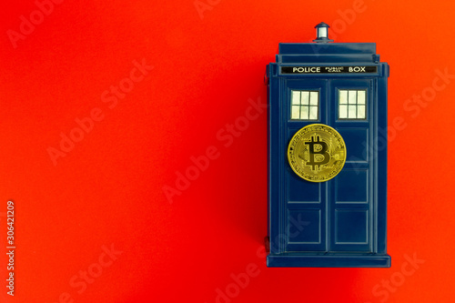 Fotografie, Obraz Police call box in front of red background flat lay