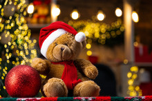 Christmas Gift Toys. Teddy Bear Gift From Santa. Merry Christmas And Happy Holidays. Presents In Room. Christmas Teddy Bear With Christmas Ball On Beautiful Decoration Background.