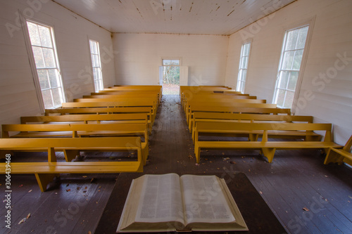 A view of a country church from the pulpit with an open bible. Canvas Print