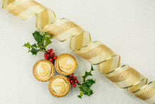 3  Traditional British Christmas Biscuit Mince Pie And Christmas Tree Branch With Gold Ribbon